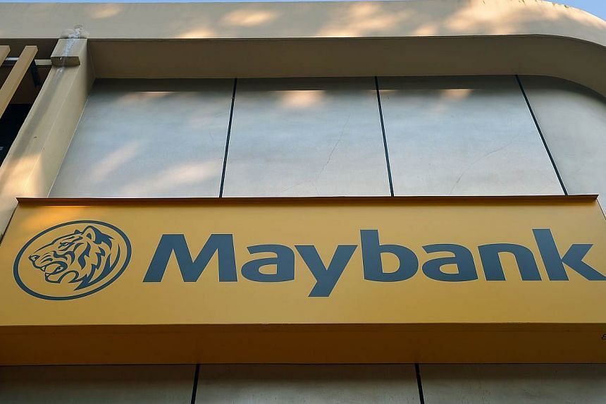 Maybank posted a better than expected 6.3 per cent rise in quarterly profit, but gave a cautious outlook due to the launch of a new consumer tax in Malaysia in April. -- ST FILE PHOTO