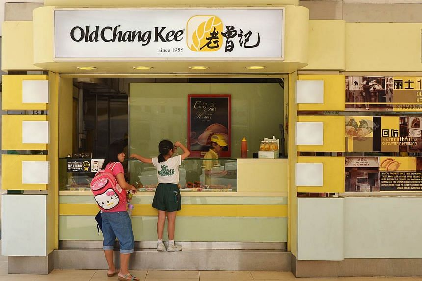 Full-year earnings at curry puff maker Old Chang Kee fell 1.5 per cent to $5.4 million. -- ST PHOTO: ALPHONSUS CHERN