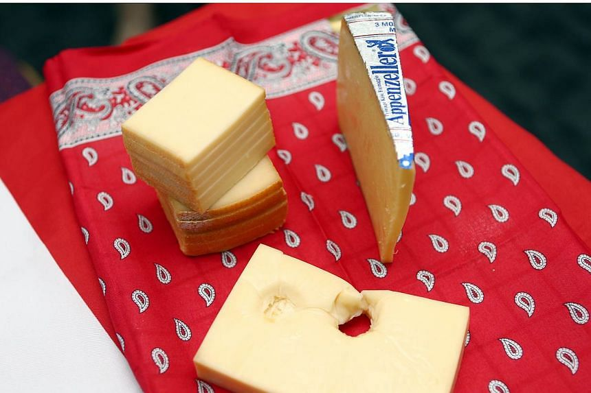 Scientists have finally found out what causes the distinctive holes to appear in Swiss cheese, after about a century of research. -- PHOTO: LIANHE ZAOBAO