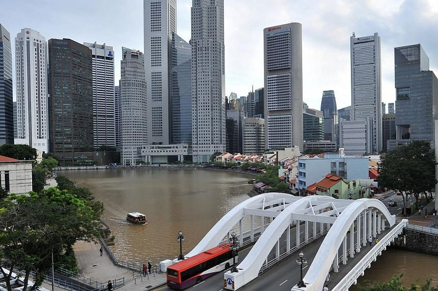 Singapore stood third, behind Hong Kong and The United States, for the second year in a row in the annual world competitive ranking 2015, released by the IMD World Competitiveness Center on Thursday. -- ST PHOTO: LIM YAOHUI