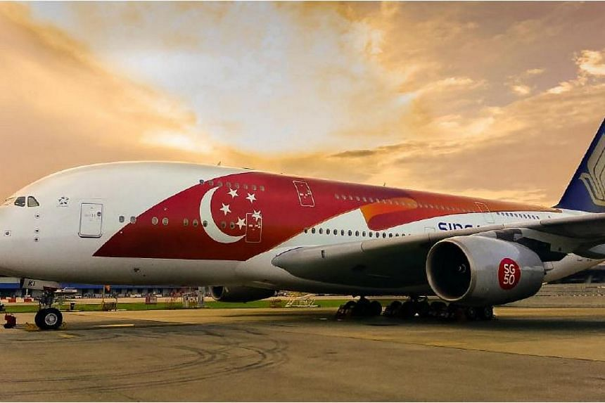 Singapore Airlines (SIA) is celebrating the nation's Golden Jubilee by having two Airbus 380s in a special livery, featuring a large Singapore flag-themed design on the fuselage. -- PHOTO: SINGAPORE AIRLINES
