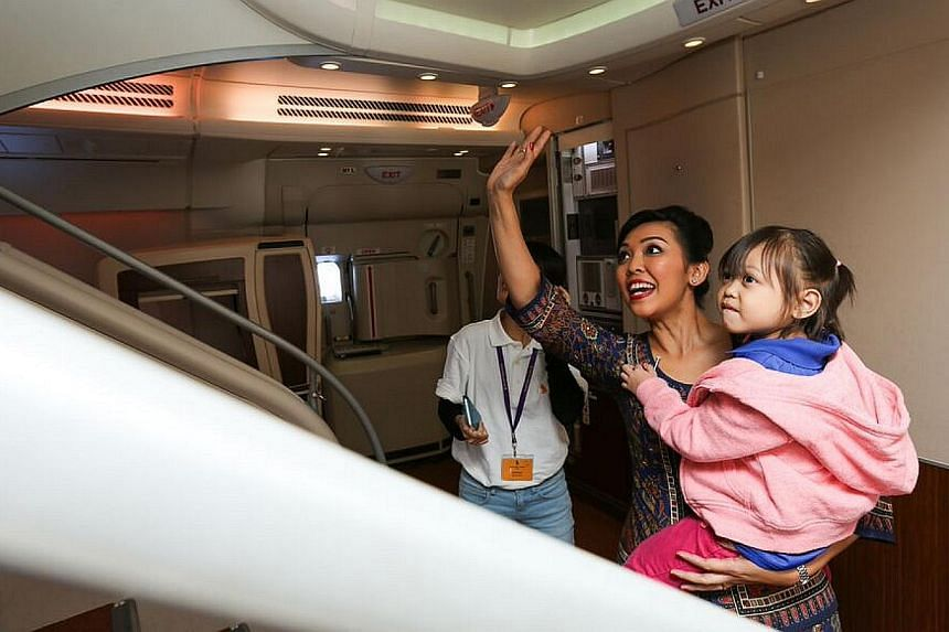 A beneficiary taking a tour of the A380. -- PHOTO: SINGAPORE AIRLINES