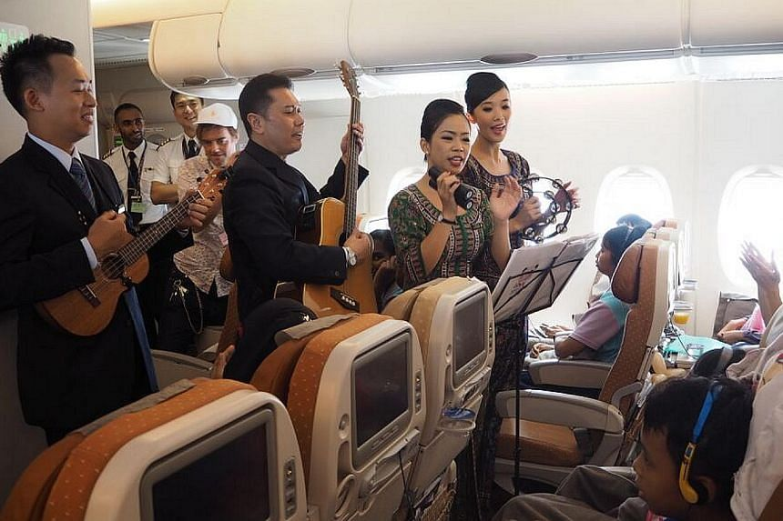 Cabin crew performing for the passengers of the flight. -- PHOTO: SINGAPORE AIRLINES