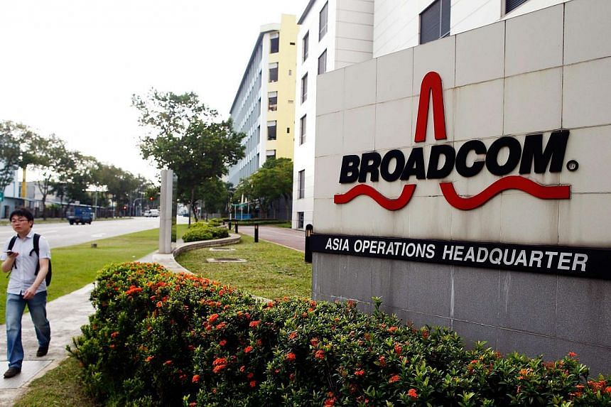 A man passes Broadcom's Asia operations headquarters office at an industrial park in Singapore. -- PHOTO: REUTERS