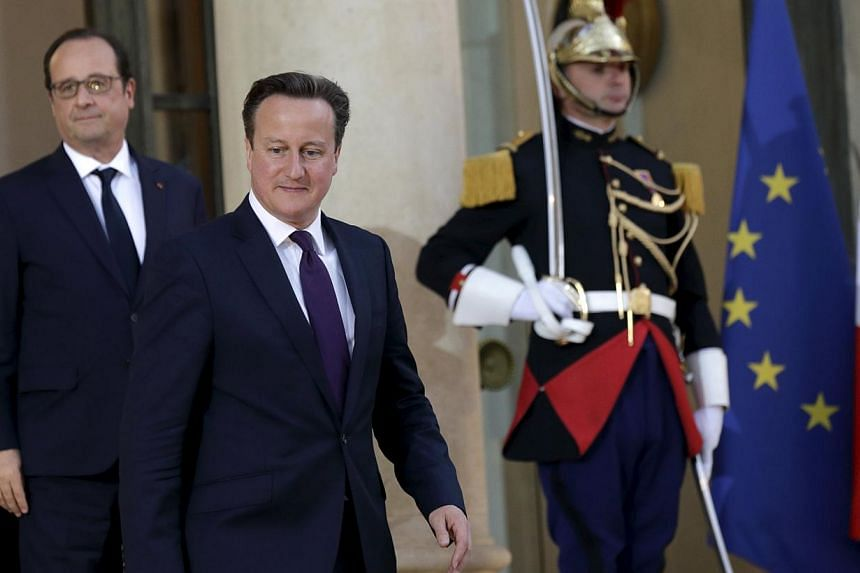 French President Francois Hollande (left) accompanying Britain's Prime Minister David Cameron as he leaves the Elysee Palace after a meeting in Paris, France, on May 28, 2015. -- PHOTO: REUTERS