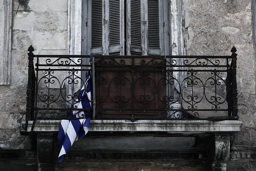 Greece's exit from the eurozone is a possibility but would not signify an end to the single currency, International Monetary Fund chief Christine Lagarde said in a newspaper interview Thursday. -- PHOTO: AFP