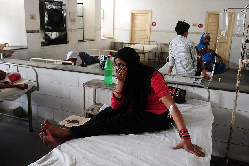 Patient Nansi Bano gesturing as she sits on a bed in a government hospital in Allahabad on May 28, 2015, as scorching weather conditions continue across India. -- PHOTO: AFP