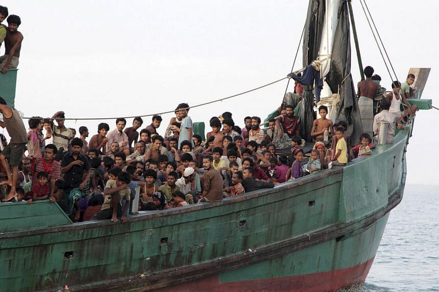 Rohingya and Bangleshi migrants waiting on board a fishing boat before being transported to shore, off the coast of Julok, in Aceh province on May 20, 2015, in this photo taken by Antara Foto. -- PHOTO: REUTERS