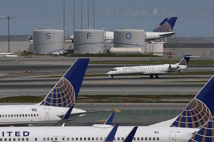 A United Airlines plane taxis on the runway at San Francisco International Airport on March 13, 2015 in San Francisco, California. A Canadian singer-songwriter was kicked off a United Airlines flight in San Francisco because her two-year-old toddler