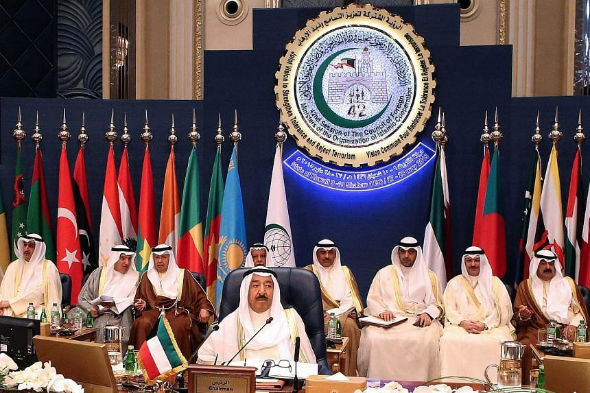 """Emir of Kuwait Sheikh Sabah al-Ahmad al-Jaber al-Sabah (centre) chairs the opening of the 42nd Session of the Council of Foreign Ministers (CFM) of the Organization of Islamic Corporation (OIC) with the theme """"Joint Vision to Strengthen Tolerance and"""