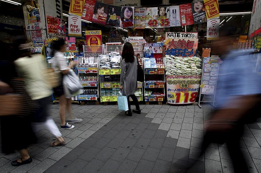 A woman looking at items outside a discount drug store in Tokyo, Japan, on May 28, 2015. -- PHOTO: REUTERS