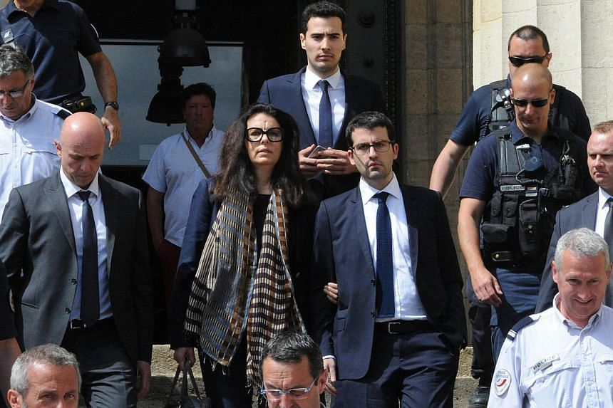 Francoise Bettencourt-Meyers (centre), daughter of France's richest woman Liliane Bettencourt, flanked by her sons Nicolas (at her left) and Jean-Victor (centre,background), leaves on May 28, 2015, the Bordeaux courthouse, south-western France, after
