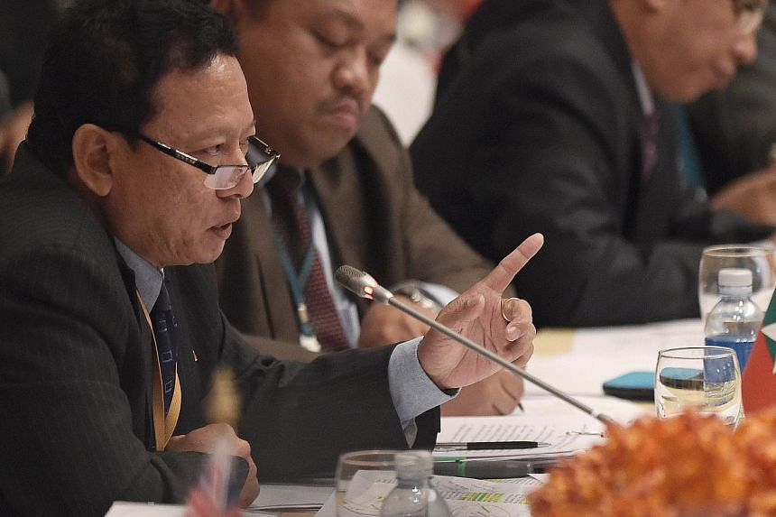Myanmar's Foreign Ministry Director-General Htin Lynn speaking during an international meeting on migration in the Indian Ocean attended by delegates from 17 nations in Bangkok on May 29, 2015. -- PHOTO: AFP