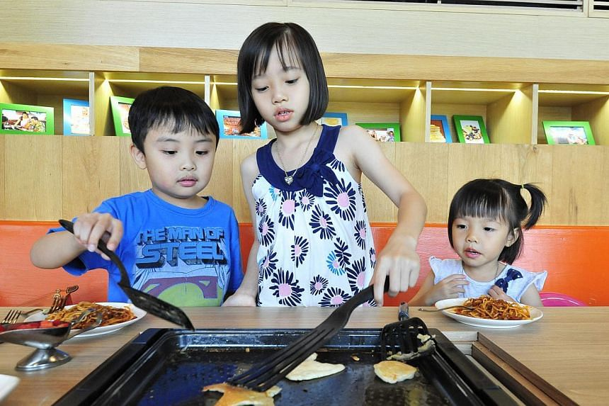 Flip your own pancakes at the table at Slappy Cakes. -- PHOTOS: WONG KWAI CHOW, GURVEEN KAUR, DIOS VINCOY JR FOR THE STRAITS TIMES, DISTRICT 10, TIMBRE/WONG LIANG PIOW, TREEHOUSE CAFE, WHISK & PADDLE