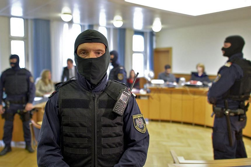 Police guarding the courtroom before the start of a trial of a teenager for allegedly supporting ISIS, in Vienna, Austria, on Tuesday. Meanwhile, a 14-year-old (right) was sentenced to eight months' jail for plans to join ISIS extremists in Syria, an