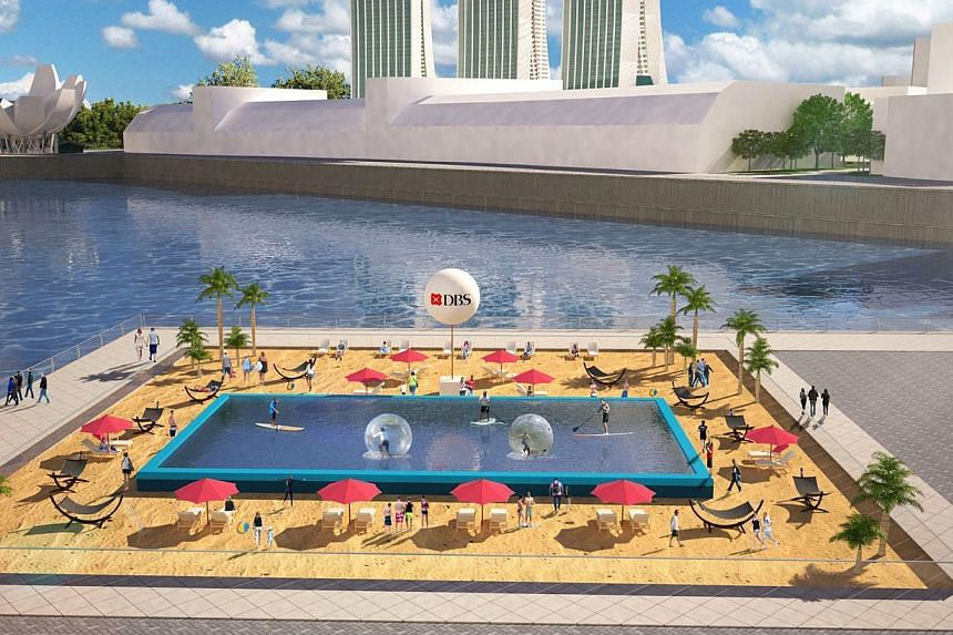 An artist's impression of the first urban beach here, which will be set up at The Promontory @ Marina Bay on June 13 and 14. It measures 50m by 50m and is made from 28,000kg of sand. -- PHOTO: DBS
