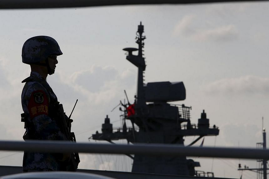 A member of the People's Liberation Army navy standing guard on a Chinese vessel. China's White Paper released on Tuesday paints a new and expansive view of the country's maritime power, while signalling a shake-up of some traditional combat structur