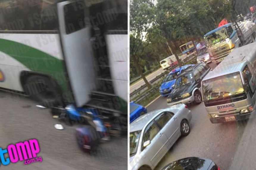 A motorcycle was crushed under a bus in an accident involving a motorcycle, a bus and a lorry on the AYE on Friday morning. -- PHOTO: STOMP