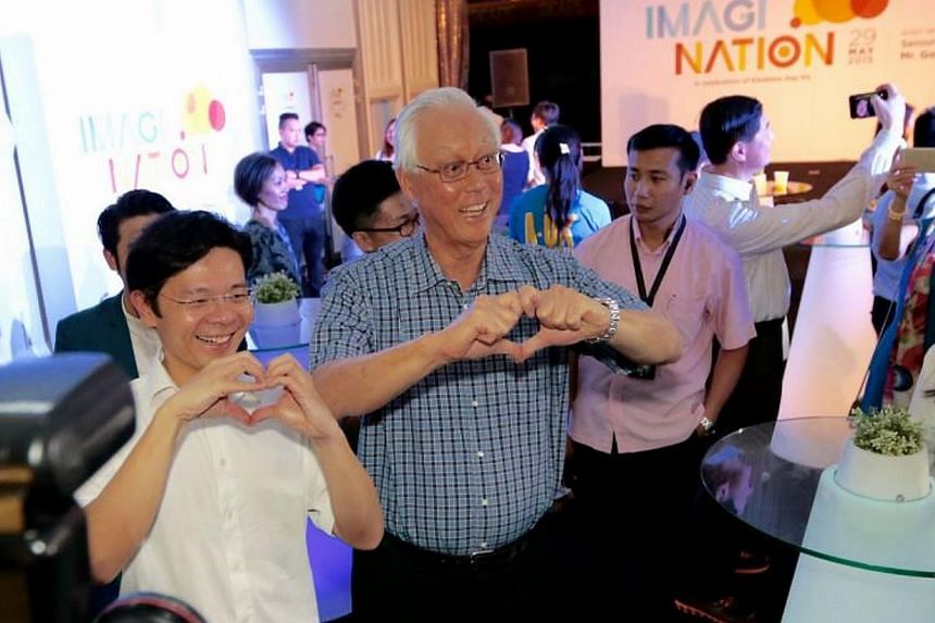Emeritus Senior Minister Goh Chok Tong (centre) and Minister Lawrence Wong at the launch of ImagiNation - an exhibition at *Scape created in celebration of Kindness Day SG on May 29, 2015. -- PHOTO: SINGAPORE KINDNESS MOVEMENT