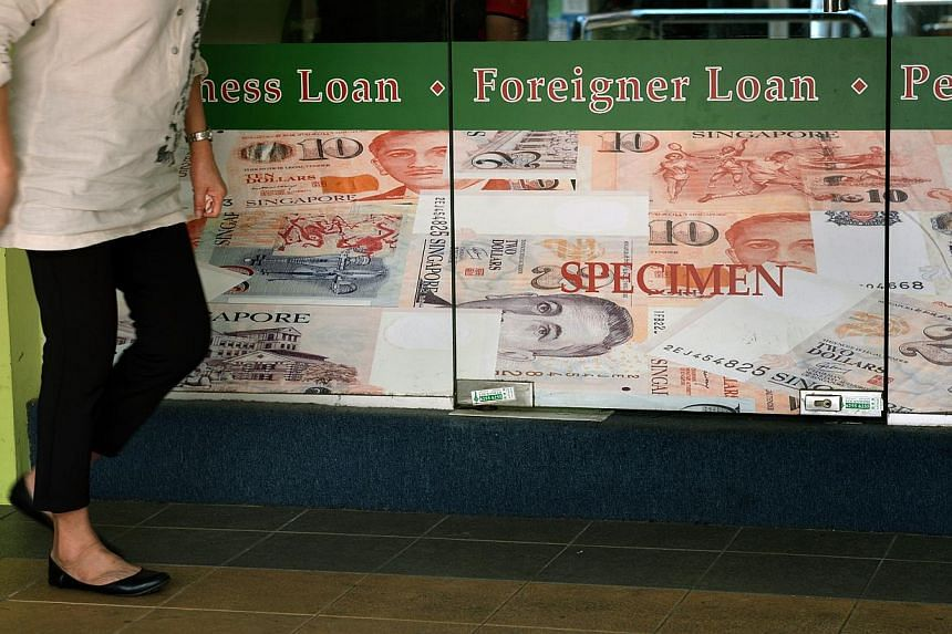 An advisory committee on Friday proposed an interest rate cap of 4 per cent a month and a late-payment interest capped at 4 per cent a month, that licensed moneylenders are allowed to charge borrowers. -- PHOTO: ST FILE