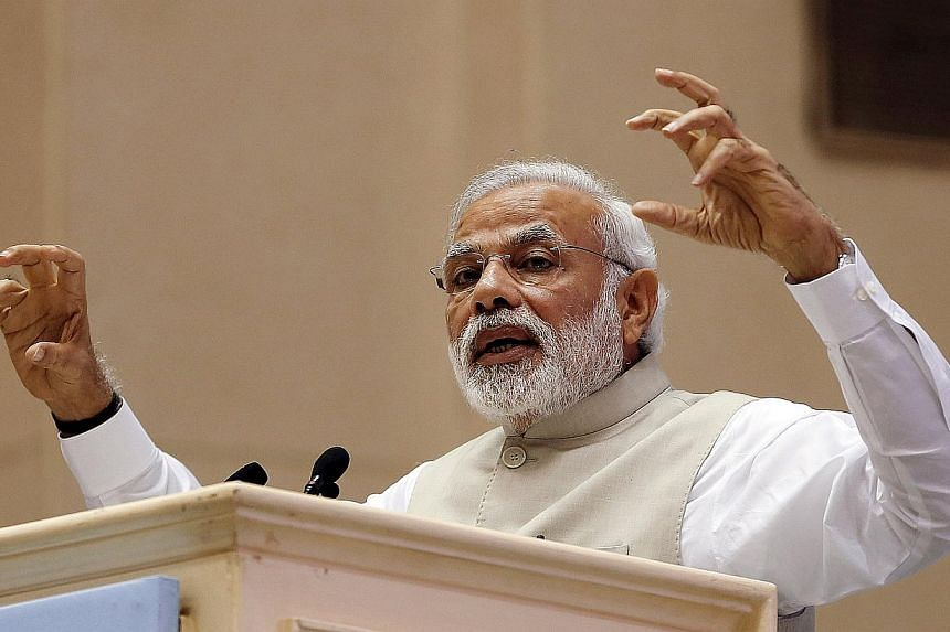 India's Prime Minister Narendra Modi speaks at the inaugural session of RE-Invest 2015, the first Renewable Energy Global Investors Meet & Expo, in New Delhi, India, in this February 15, 2015 file photo. India on May 29 reported economic growth o