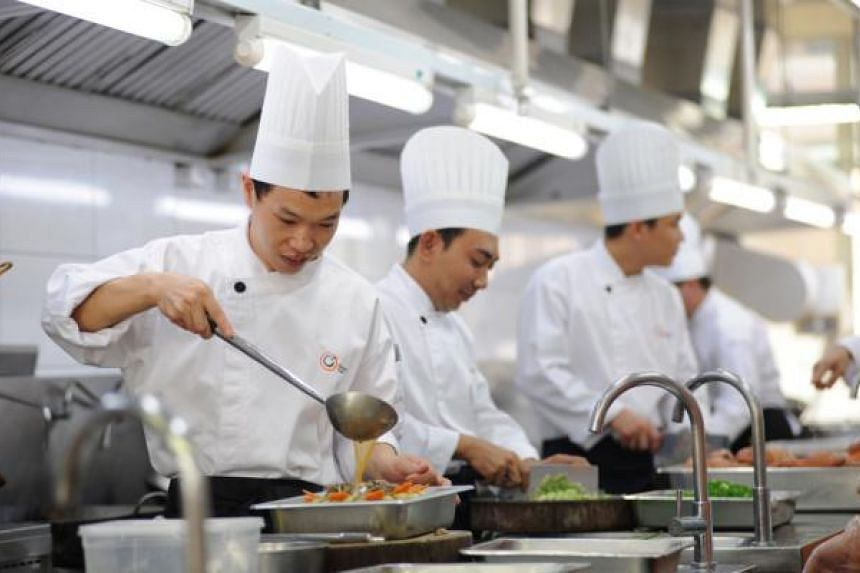 Chefs working in a central kitchen of Neo Group, a food and catering company. -- PHOTO: NEO GROUP LIMITED