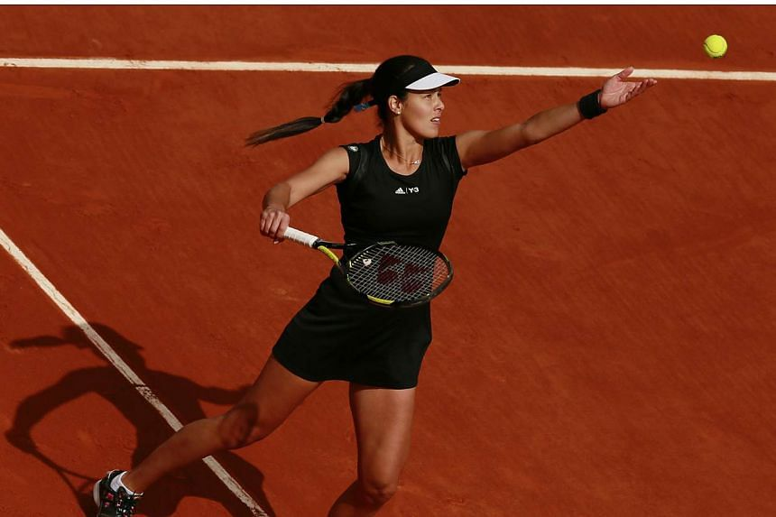 Former champion Ana Ivanovic reached the French Open last 16 in just 53 minutes on Friday while Alize Cornet kept home hopes alive by making the second week for the first time. -- PHOTO: REUTERS