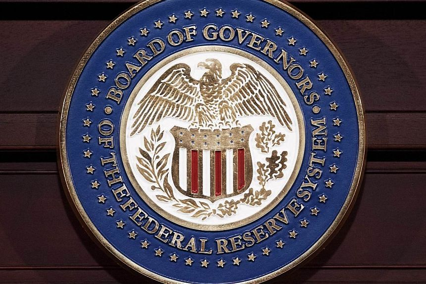 This June 19, 2013 file photo shows the seal of the Federal Reserve Board of Governors in Washington, DC. The world's largest economy hit a bigger ditch in the first quarter than initially estimated, held back by harsh winter weather, a strong dollar