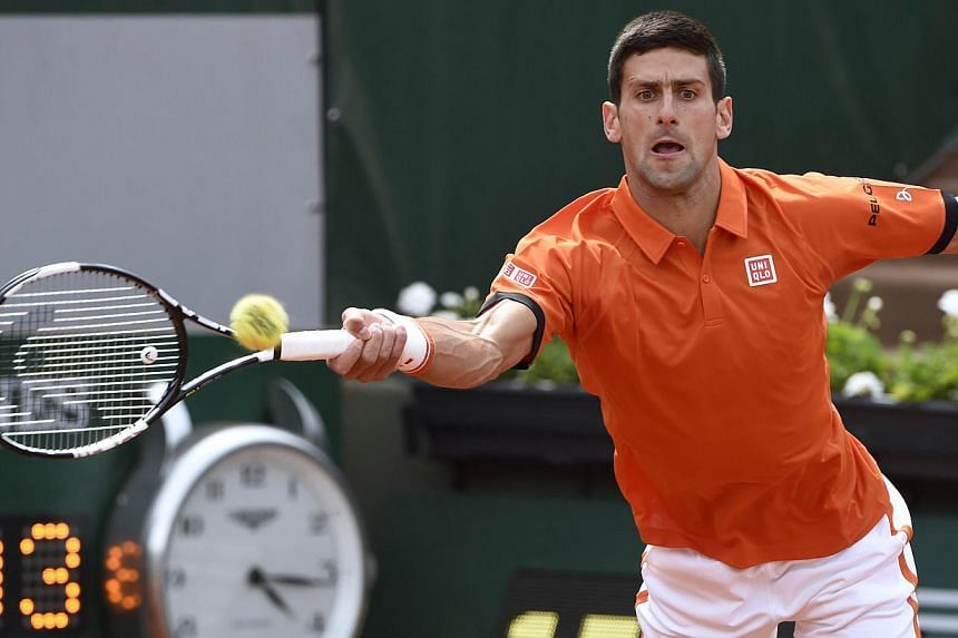 Serbia's Novak Djokovic returns the ball to Luxemburg's Gilles Muller during the men's second round at the Roland Garros 2015 French Tennis Open in Paris on May 28, 2015. -- PHOTO: AFP