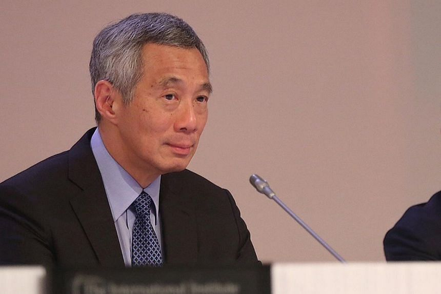 Mr Lee was speaking at the opening of the annual Shangri-La Dialogue security summit. The terrorism threat simmering in Southeast Asia was a topic he touched on in his wide-ranging speech.-- ST PHOTO:NEO XIAOBIN
