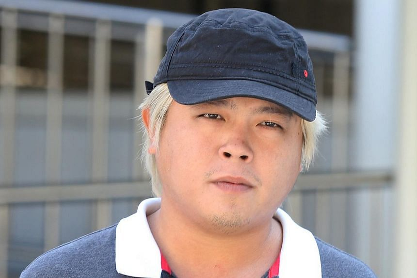 Jover Chew leaving the State Courts on Friday.His mother posted $40,000 bail. -- ST PHOTO:SEAH KWANG PENG