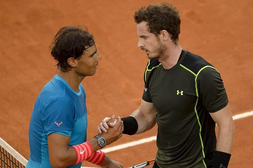 Rafael Nadal (left) shake hands to Scottish tennis player Andy Murray at the end of the men final of Madrid Open tournament at the Caja Magica (Magic Box) sports complex in Madrid on May 10, 2015. Murray won 6-3, 6-2. -- PHOTO: AFP