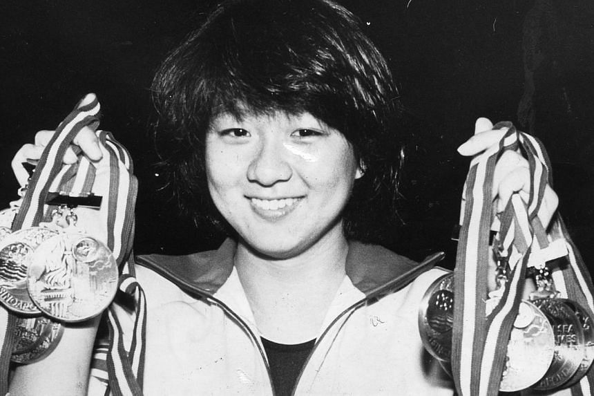 Swimmer Junie Sng retired aged only 19. She won 10 golds in 10 days. The opening ceremony of the 12th SEA Games at the National Stadium on May 28, 1983 was so wet it made it look like the 'Umbrella Games' instead.