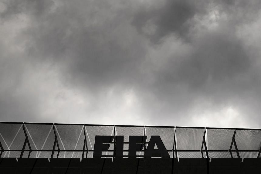 A logo of the Fifa is seen at the top of its headquarters on May 27, 2015 in Zurich. -- PHOTO: AFP
