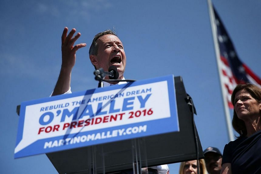 Former Maryland Governor Martin O'Malley (left) speaks as his wife Katie looks on during an event to announce his candidacy for a presidential campaign on May 30, 2015 at Federal Hill Park in Baltimore, Maryland. -- PHOTO: AFP