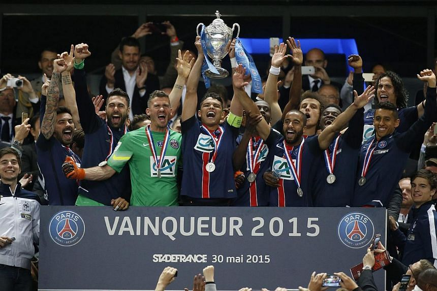 Paris St Germain's players celebrate with the trophy after winning the Coupe de France final match between Paris Saint Germain (PSG) and AJ Auxerre at the Stade de France in Saint-Denis outside Paris, France, on May 30, 2015. -- PHOTO: EPA