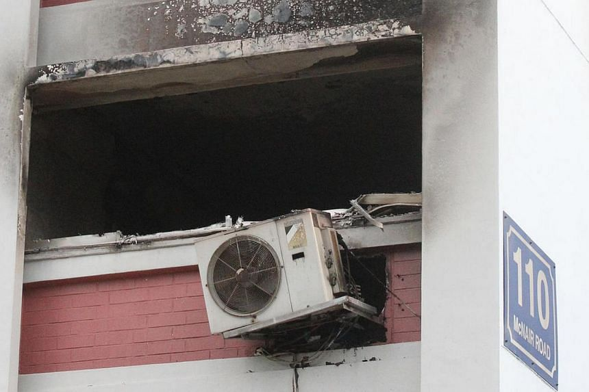 The blackened window of the flat after the fire was put out. --PHOTO: LIANHE WANBAO
