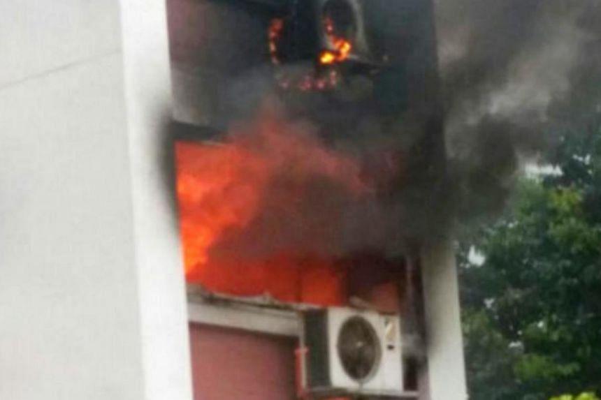 A fire broke out at this third floor flat at Block 110 McNair Road on Saturday (May 31). -- PHOTO:SHIN MIN DAILY NEWS