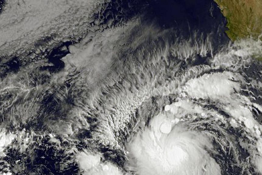 This image obtained from the NOAA-NASA GOES Project shows Tropical Storm Andres (bottom) on May 28, 2015. -- PHOTO: AFP