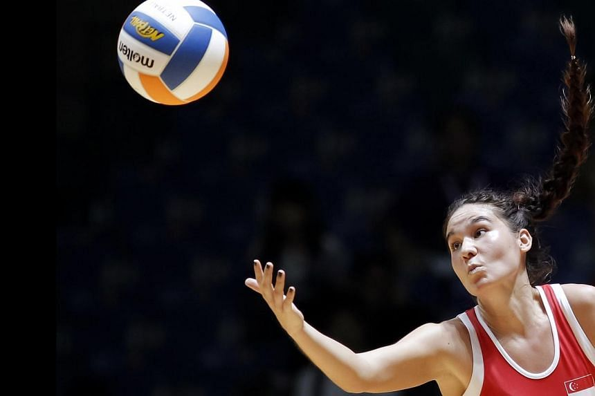 Shelby Koh in action as Singapore got off to a winning start in the SEA Games netball competition with a resounding 72-21 win over Brunei on Sunday. -- PHOTO: REUTERS