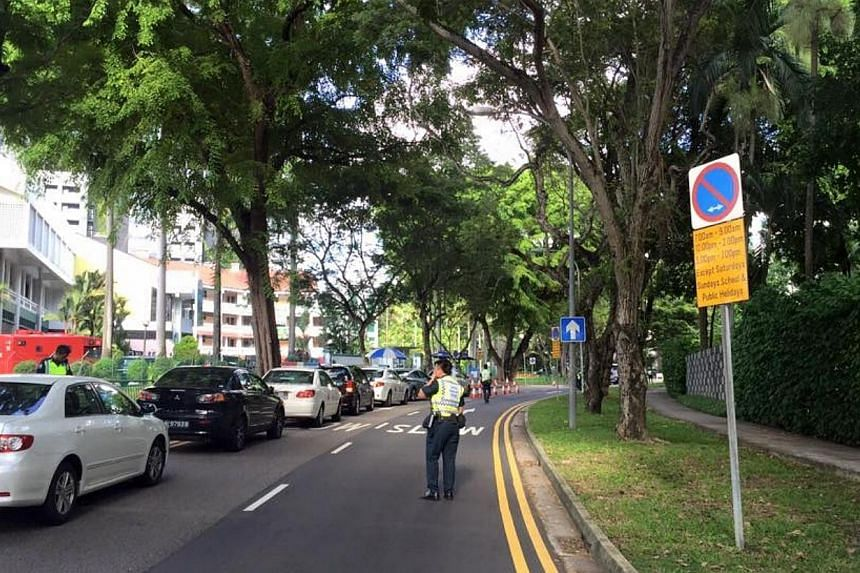 Police officers manning the cordon at Anderson Road near the Stevens Road entrance.Three men travelling in a car dashed through a checkpoint and police barricades near Shangri-La Hotel when police asked to inspect the car boot on Sunday, May 31