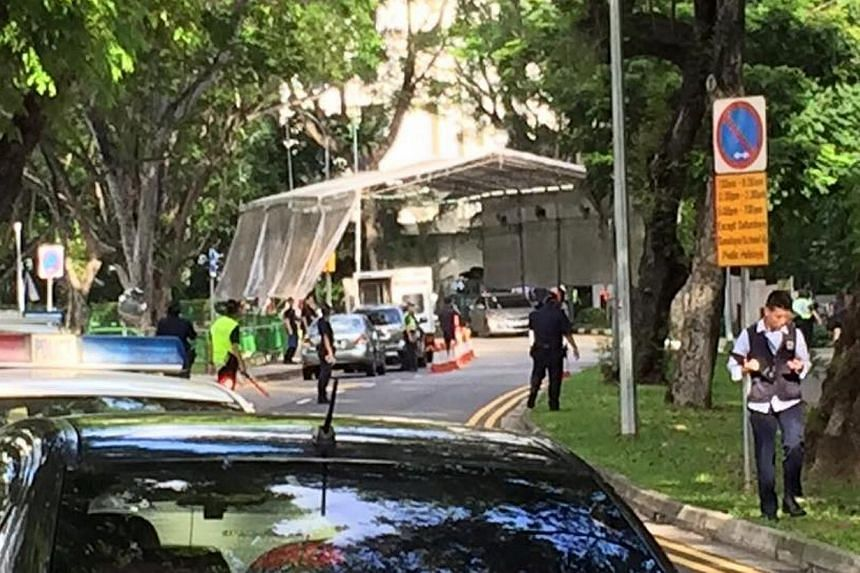 The police cordon at Anderson Road near the Stevens Road entrance. Three men travelling in a car dashed through a checkpoint and police barricades near Shangri-La Hotel when police asked to inspect the car boot on Sunday, May 31, 2015. Police fired a