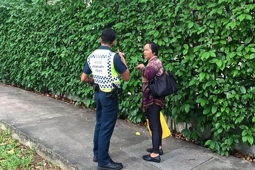 A passer-by being turned away by a police officer.Three men travelling in a car dashed through a checkpoint and police barricades near Shangri-La Hotel when police asked to inspect the car boot on Sunday, May 31, 2015. Police fired at the car,