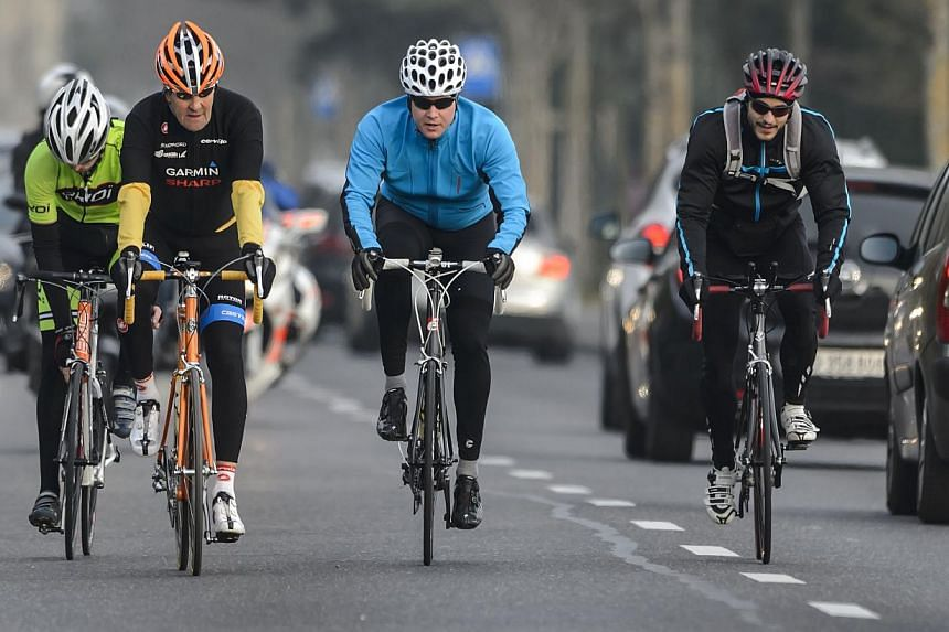 United States Secretary of State John Kerry (second left) rides his bike during a break in Lausanne on March 16, 2015.Mr Kerry has been hospitalised after suffering a leg injury from a cycling accident in France, the US State Department said on