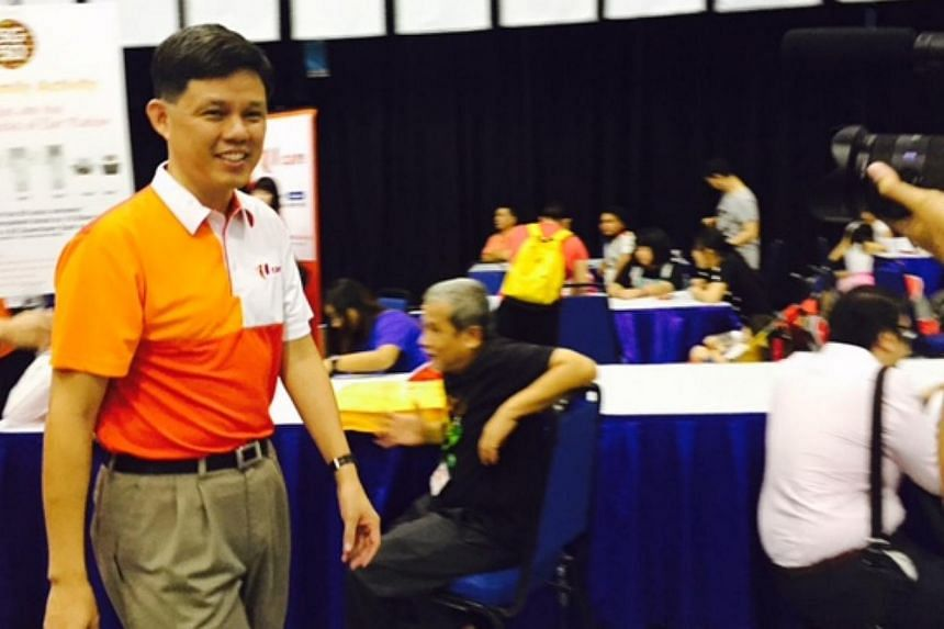 Labour chief Chan Chun Sing announced at a carnival in Pasir Ris on Sunday that the NTUC will be adjusting income caps for two of its voucher schemes so as to benefit more of its members. -- ST PHOTO: AUDREY TAN
