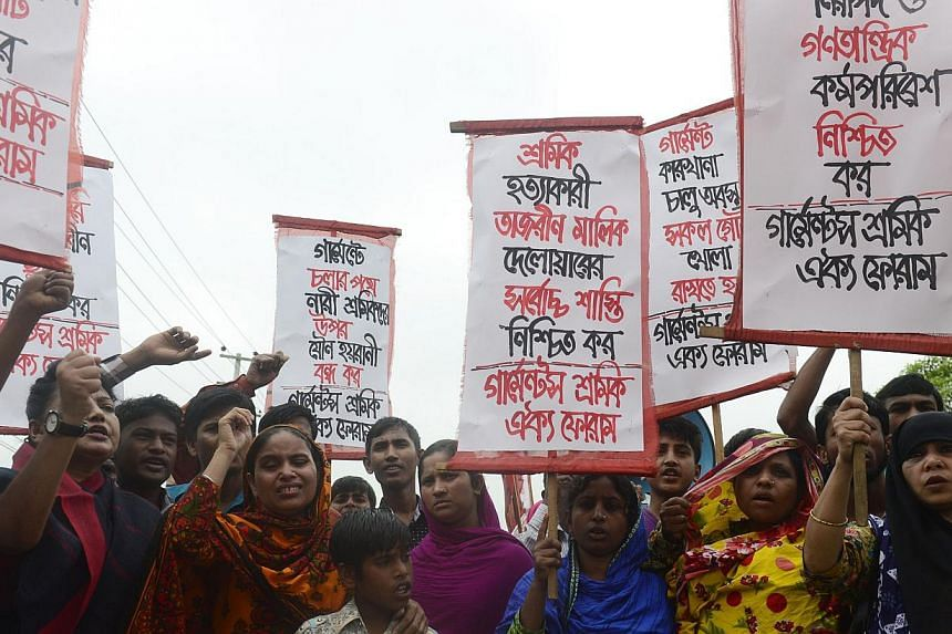 Memebers of Bangladeshi garments worker union shout slogans as they mark the second anniversary of the Rana Plaza building collapse at the site where the building once stood in Savar, on the outskirts of Dhaka on April 24, 2015. Bangladesh police sai