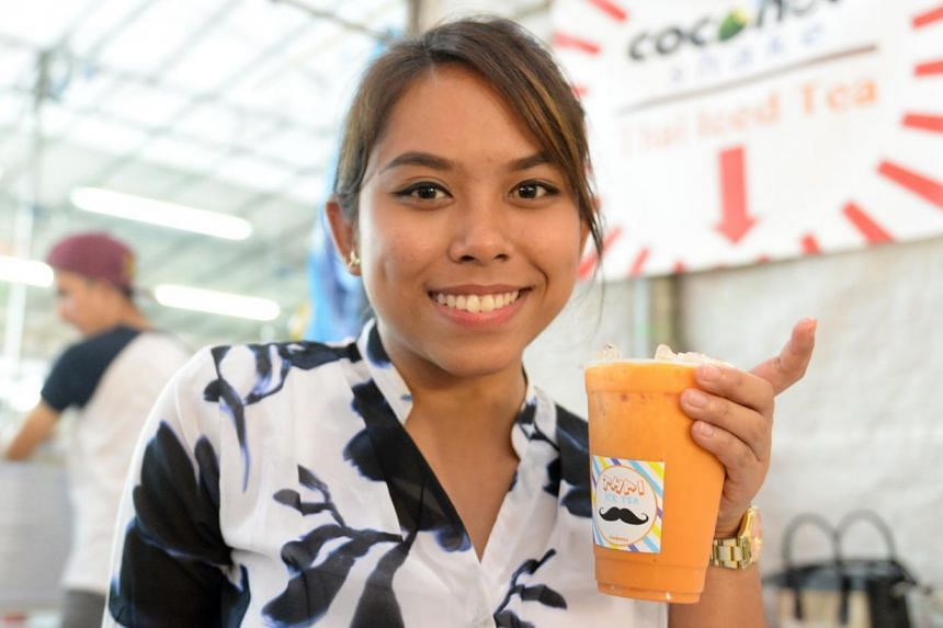 Ms Miza Nazili at her stall Iceburnz, which specialises in Thai ice milk tea, at a pasar malam in Woodlands recently. -- ST PHOTO: AZIZ HUSSIN