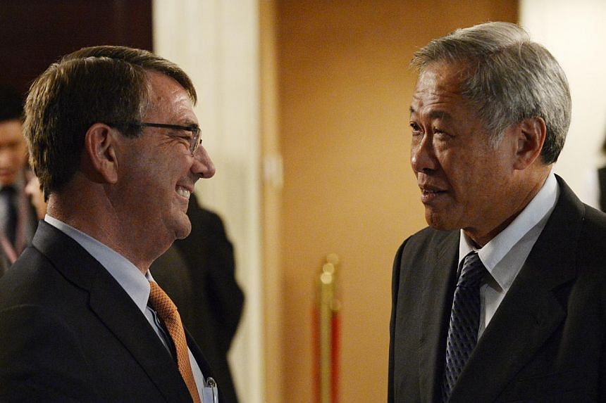 Singapore Defence Minister Ng Eng Hen (right) with US Secretary of Defence Ashton Carter during the ministerial luncheon yesterday. Dr Carter spoke at the Shangri-La Dialogue as Pentagon chief for the first time.