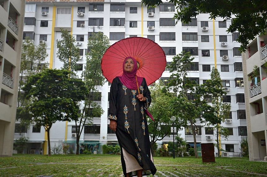 Ms Saleemah in front of the block of flats in Circuit Road where she has lived all her life, and where she had witnessed suicide, domestic violence, gang fights and drug abuse in the 1970s.