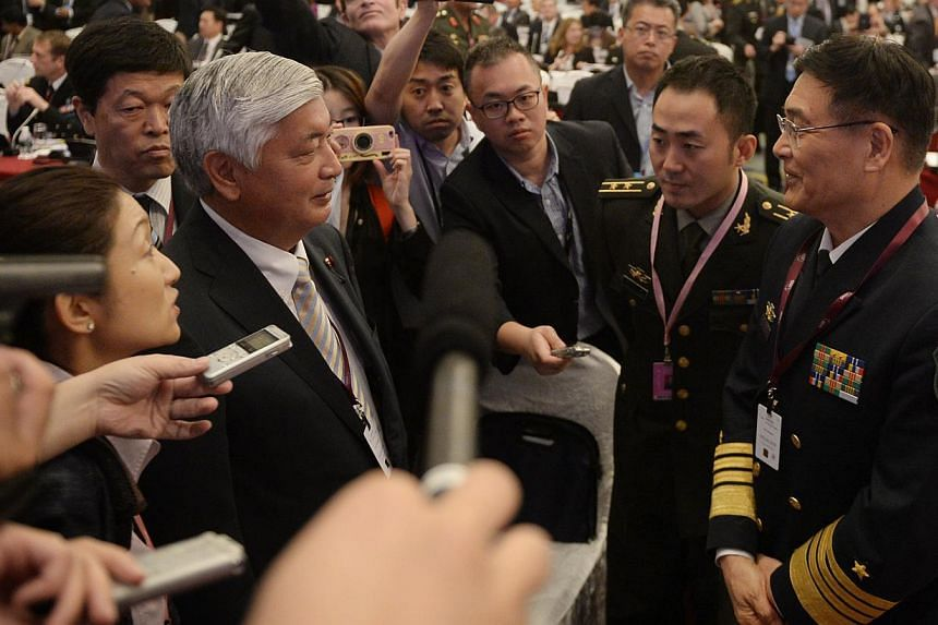 Japanese Defence Minister Gen Nakatani (left) speaking with Admiral Sun Jianguo, Chinese deputy chief, General Staff Department, People's Liberation Army, during the IISS Shangri-La Dialogue yesterday.